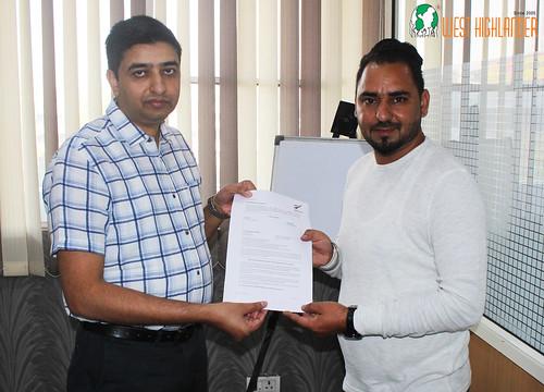 Mr. Gurvinder Singh (Director of West Highlander) handing over New Zealand Dependent Visitor Visa to Sukhjinder Singh Nijjar