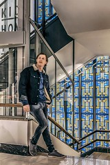 Waiting for a friend (Dannis van der Heiden) Tags: modelphotography model amersfoort hudsonbay netherlands store fashion stainedglass colors colours wouter nikond750 d750 tamron2470mmf28 elevator stairs window vd pose people art jeans shoes