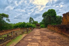 East Mebon temple ruins in Angkor Archeological Park near Siem Reap, Cambodia (UweBKK (α 77 on )) Tags: east mebon eastmebon temple ruins elephant statue angkor archeological park archeology ancient history historical stone siem reap cambodia southeast asia sony alpha 77 slt dslr trees jungle forest sky clouds grey