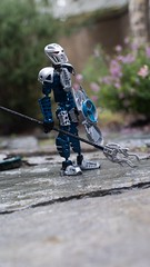 Outside (-Sad-) Tags: lego bionicle legos legophotography bioniclephotography outside rain toa toahagah gaaki toy toyphotography nature