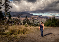 Me in the Welsh Hills (zeon7) Tags: portrait man environment hills forest trees mountains clouds storm grass jeans vest face blue green legs arms full body gravel fields horizon sky wales north
