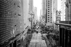Mongkok (Bill Thoo) Tags: mongkok 旺角 hongkong 香港 landscape travel city cityscape street urban architecture buildings road monochrome bnw blackandwhite blackandwhitefilm blackandwhitefilmphotography film analog analogue filmphotography analogphotography analoguephotography filmcamera 35mm 35mmfilm 35mmfilmphotography 35mmfilmcamera lecia m4 leicam4 voigtlander voigtlandercolorskoparpii3525 3525 kodak tmax kodaktmax kodaktmax400 push2 push2stops pushed2stops pushed2