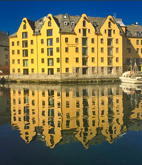 Hotel Brosundet (alnesleif2) Tags: arch bridge canal reflection tourboat moat aalesund norway quayside packhouse fishing industry clarion collection hotel seascape sea brosundet historical