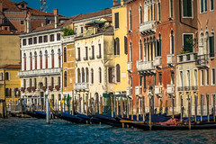 The gondola is a traditional, flat-bottomed Venetian rowing boat, well suited to the conditions of the Venetian lagoon. It is similar to a canoe. It is propelled by a gondolier, who uses a rowing oar.