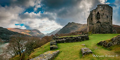 Dolbadarn Castle Snowdonia (Adrian Evans Photography) Tags: ancient welsh snowdonia historic dinorwicslatequarry monument cadw lake welshcastle dolbadarncastle wales llanberispass dinorwigquarry uk british quarry architecture castle landscape welshmountain llanberis landmark winter winterlandscape snowcapped clouds snow welshlandscape welshlandmark grass snowdon britain padarn adrianevans sky snowdonmoutainrange heritage hills ruins northwales edwardian mountain nikon d850 20mm