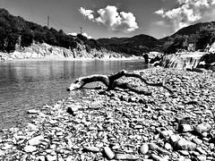 Drawn away from the birthplace. (AchillWandering) Tags: stones blackandwhite bw acheloos greece templas aetoloacarnania sky water branch river vowel rocks