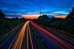 B66 (Bielefeld-Ubbedissen, Germany) (Jens Flachmann) Tags: e lighttrails bielefeld germany highway traffic availablelight batis225 dusk sky street clouds
