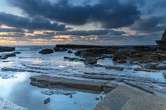 A Moody Sunrise Seascape (Merrillie) Tags: daybreak theskillion nature australia terrigal rocky morning sea waterscape newsouthwales rocks earlymorning nsw coast landscape ocean dawn cloudy sunrise coastal clouds outdoors seascape waves centralcoast water sky