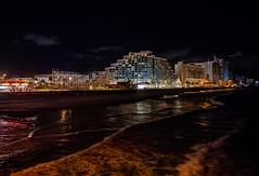 Daytona Boardwalk from the Pier (RansomedNBlood) Tags: daytona nikon1 fl florida beach waves nighttime boardwalk hotels