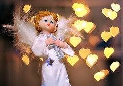 Christmas Angel with Love Hearts (Martyn.Hayes) Tags: christmas stilllife bokeh softfocus closeup decoration xmas seasonal festive joy happy tree snow christmaslights fairylights angel fairy holy christian cross faith wings feathers cherub