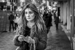 Messaging (Leanne Boulton) Tags: portrait people urban street candid portraiture streetphotography candidstreetphotography streetportrait candidstreetportrait streetlife woman female girl pretty face eyes expression mood feeling emotion mobile phone smartphone device technology beauty beautiful hair fur style fashion tone texture detail depthoffield bokeh naturallight outdoor light shade city scene human life living humanity society culture lifestyle canon canon5dmkiii 70mm ef2470mmf28liiusm black white blackwhite bw mono blackandwhite monochrome glasgow scotland uk