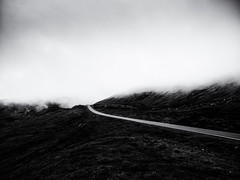 Beyond (Feldore) Tags: faroeislands road mysterious moody landscape mist misty fog foggy ethereal dark clouds faroe feldore mchugh em1 olympus 1240mm hill mountain beyond menace