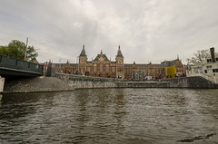 Central Station from Ring Canal (rschnaible) Tags: amsterdam netherlands outdoor landscape europe water sky barge central station building architecture