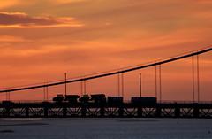 Transport (Cederquist Christoffer) Tags: bridgewatersunsetskyseatraveltravelingcityeveningdawnarchitectureriverduskpieroceansteelvehicle silhouette truck älvsborgsbron göteborg sverige gothenburg sweden orangesky tamron150600 tamron150600g2 tamron