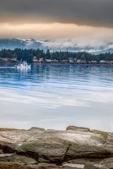 Boat cruises through Beachcomber (kellypettit) Tags: boat snowcappedmountains colderdays vancouverisland westcoast landscape nanoosebay beautifulbc explorebc explorevancouverisland