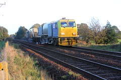 Network Rail MPV pair DR98954 leading DR98904 catch a late bit of Autumnal sun as they are seen leaving Burscough Bridge on route to Southport with 3S08 RHTT on Sunday 14th October 2018 © (steamdriver12) Tags: network rail mpv multi purpose vehicle dr98954 dr98904 late autumnal sun burscough bridge route southport with rhtt head treatment train sunday 14th october 2018 lancashire england railway maintenance countryside
