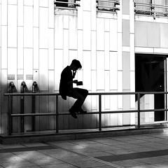 Smoking his cigarette (pascalcolin1) Tags: paris13 homme man cigarette mur wall lumière light soleil sun ombres shadows barrier barriere photoderue streetview urbanarte noiretblanc blackandwhite photopascalcolin 50mm canon50mm canon carré square