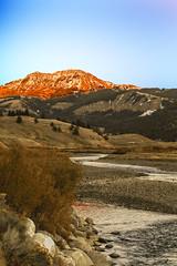 Last Light (wyojones) Tags: wyoming yellowstonenationalpark lamarvalley sodabuttecreek mountnorris absarokamountains peak mountain sunset sunlight creek water alpenglow