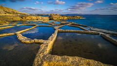 privat salt pans (K.H.Reichert [ not explored ]) Tags: longexposure pool ocean 102018xattlahmar malta sunset sunstar sky sea gozo coast langzeitbelichtung rocks