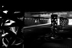 Under the lit tunnel (pascalcolin1) Tags: paris13 femme woman tunnel chanel lumière light lit éclairé éclairage lampadaire lamppost noir black photoderue streetview urbanarte noiretblanc blackandwhite photopascalcolin 50mm canon50mm canon