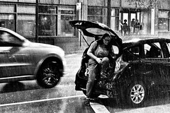 Wabash and Lake - Storm - 2 (draketoulouse) Tags: chicago loop downpour storm rain thunder night woman traffic street wabash city streetphotography people blackandwhite monochrome car bw