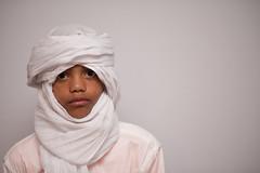 Simplistic (Rushay) Tags: african background copyspace head headscarf kid minimalism portelizabeth portrait southafrica tuareg watching white