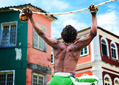 Brazilian performing Capoeira with Berimbau Instrument in Salvador, Bahia, Brazil. (terraexperiences) Tags: northeastern trail tour capoeira bahia brazil afro african brazilian man adult berimbau southamerica latinamerica salvador pelourinho pelorinho colorful america tropical music instruments dancer male northeast africa martial fitness acrobatic people dance caucasian black spectacular performing performer brasil games dreadlocks young person muscular capoeria outdoors musical house sports art background athletic colonial exercise performance terranossa nordeste brazilnordeste