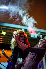 I love the way you blow. (ceruleansnake) Tags: atx austin tx club tuesgayz night life nightlife downtown queer transvestite cross dresser dressing guy man woman wig cigarette smoke blowing standing portrait makeup lipstick mustache black white bw impress hair