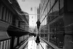 Europaallee (maekke) Tags: zürich streetphotography puddlegram reflection man europaallee bw noiretblanc fujifilm x100t 35mm rain pointofview pov 2018 ch switzerland absoluteblackandwhite