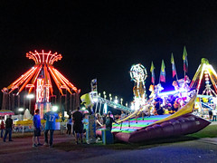 Carnival Midway At Night. (dccradio) Tags: lumberton nc northcarolina robesoncounty outdoor robesonregionalagriculturalfair fair countyfair robesoncountyfair fun entertainment communityevent night evening lights illuminated canon powershot a3400is bigrockamusements carnival midway fairride amusements amusementdevice mechanicalride ride rides thrillride outdooramusement outdoors outside yoyo carnivalswings swingride swings chance chanceindustries chancerides ropeladder extreme pendulumride clawride skywheel doubleferriswheel slide funslide superslide giantslide carnivalslide
