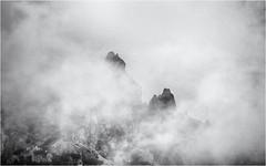 Appearing... (Ody on the mount) Tags: anlässe berge dolomiten em5ii felsen felswand fototour gipfel mzuiko40150 nebel omd olympus sellamassiv urlaub wolken bw clouds mist monochrome mountains rocks sw vertical vertikal