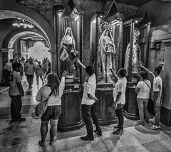 Touch of faith (FotoGrazio) Tags: monochromatic saints pilgrimage waynesgrazio travelphotography lifeinthephilippines people fotograzio culture photojournalism cebu philippines visayas basilicadelsantoniño religion church blackandwhite filipinos waynestevengrazio christian christianity monochrome sanctuary virginmary catholic travel waynegrazio tourism prayer faith