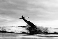 CANNON MAN (Marion Vacca) Tags: surf surfer surfeur noir et blanc black white bnw sea water vague vagues wave waves flou blur