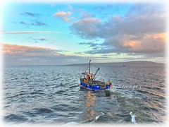 Leaving Moville, Lough Foyle, Co. Donegal. (willieguildea) Tags: boat fishingboat trawler moville donegal ireland eire water waterscape sky clouds lough sea river loughfoyle nikon p900 coast coastal coastalireland bythesea