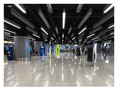Checking in or Checking out! (The Stig 2009) Tags: dubrovnik croatia air terminal strip lights white marble floor reflection green people thestig2009 thestig stig 2009 2018 tony o tonyo candid apple iphone 8 plus black