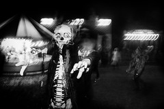 Halloween Party! (markfly1) Tags: kid lods childrens party halloween event field fun sight tents candid image rear curtain flash camera motion blur eyes smile teeth mask costume black white mono monochromatic baw hands dark bright light shadow high contrast conversion funny smiling all teetth skeleton sigma art lens 24mm wide angle iso village fair funfair rides steam collection night photography hollycombe farm nikon d750 family album