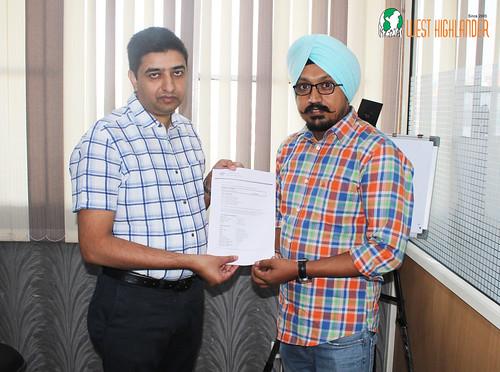 Mr. Gurvinder Singh (Director of West Highlander) handing over Australia Student Visa Visa to Baljinder Singh
