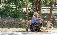 Taking A Break (Mabacam) Tags: 2018 centralasia uzbekistan bukhara thesilkroad thesilkroute architecture samonidrecreationpark woman working gardening maintenance traditional