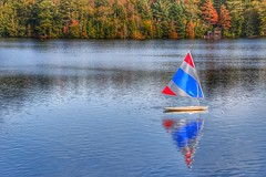 Lake Placid  - New York - Sail Boat Reflection (Onasill ~ Bill Badzo) Tags: hospital trudeau road bridge fall autumn collors reflections river dam newyork state staint st armand clintoncounty vacation travel hiking trekking sky clouds hdr tourist leaves turning fishing flyfishing boating town village adirondack mountains landscape seascape winter olympics canon eos rebel 18250mm macro sigma lens sl1 wood tree forest snow mountain mirrorlake lakeplacid colours season lake water boat grass