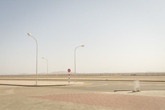 Oman, Al Sharqiyah (Alexander JE Bradley) Tags: apocalyptic desolate 1424mmf28 d500 nikon nikkor asia middleeast arabianpeninsula oman ashsharqiyahnorth alsudairah landscape scenic nature desert sand road outdoor nopeople stopsign lamp streetlamp sky day bright alexanderjebradley photograph photography travel tourism travelphotography wwwalexanderjebradleycom wwwaperturetourscom aperturetours desertflowers