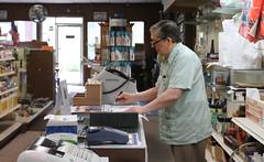 Carpenter works at the fax machine.